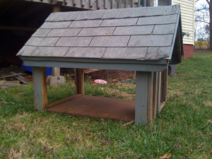 The old dog house with the sides and back cut out.