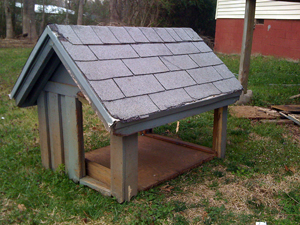 This is the front of the old dog house with the sides abd back cut out.