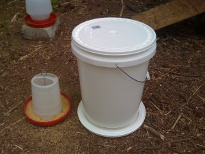 The finished Chicken Feeder next to the origianl chicken brooder feeder.